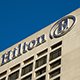Hilton Hotels is suggesting that if you�re broke, you should spend �129 a night on its hotels